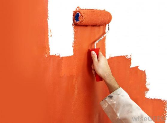 hand-painting-wall-orange